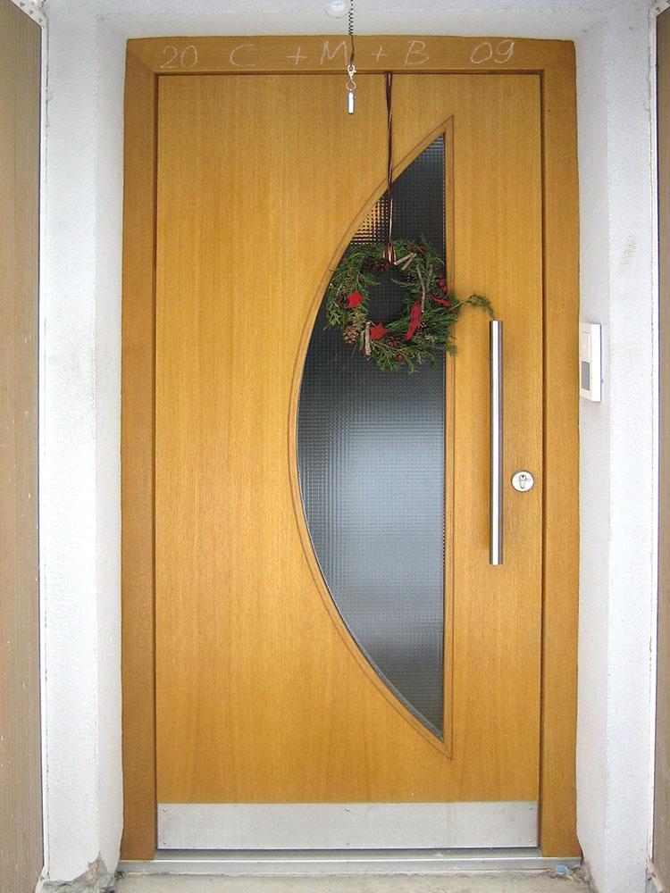 Haustür Holz mit dekorativem Glaselement